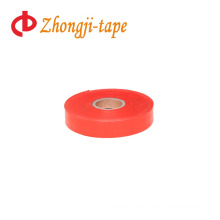 bright red flagging tape
