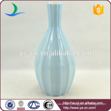 matt blue ceramic vase painted by hand for hotel decoration