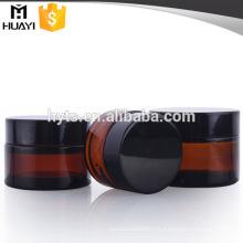 pot en verre ambre avec bouchon en plastique noir pour crème cosmétique