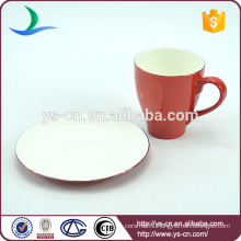 Delicate red coffee cup and saucer stands