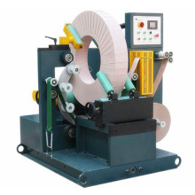 Wire rod coil ring wrapping machine