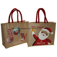 La manera diseñó la bolsa de asas impresa de la compras del yute de la Navidad