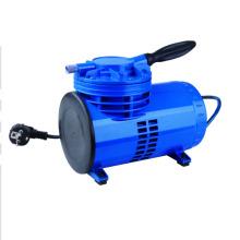 Mini compresor de aire con pistola pulverizadora.