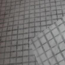 Geocompuesto de geomalla de poliéster y geotextil no tejido