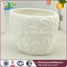 Diseño de flores Los titulares de vela de cerámica blanca al por mayor