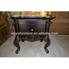 Hotel bedroom wooden carved beside table