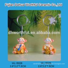 Suporte de cartão de poliresina decorativo com design de macaco