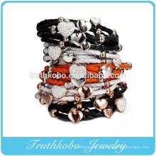 Nuevo fabricante de brazaletes de cuero de moda, brazalete de cordón de cuero redondo con aplausos de acero inoxidable