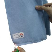Tecido não tecido com tratamento limitado de propagação de chama