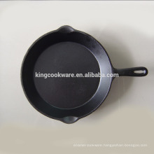 vegetable oil/ pre seasoned cast iron egg frying pan/skillet used in kitchen