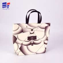 Paper shopping bag for clothing
