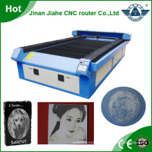 Bigger working size cnc laser fabric cutting machines 1325 with auto feed