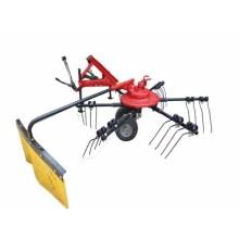 Tractor mounted hay raker