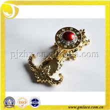 elegant plastic or metal golden curtain hook with red gem