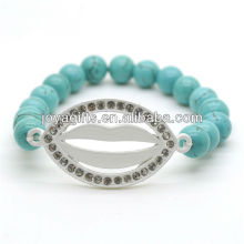 Bracelet en pierres précieuses élastique en perles rondes 8MM Turquoise avec lèvre diamant au milieu