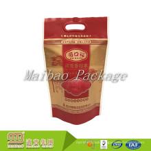 China Manufacturer Custom Brand Name Color Design Die Cut Handle Laminated Plastic Eco Rice Bag For Wholesale