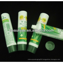 labeling cosmetic tube with plastic cap