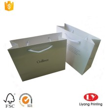 Luxury white paper shopping bag with handle