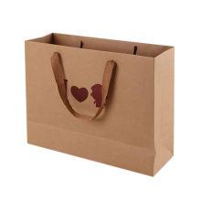 Low price professional customized logo brown paper clothing bag packaging shopping bag