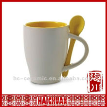 Ceramic coffee mug with spoon, porcelain cup with spoon
