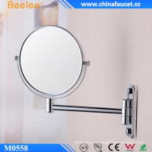 Espejo extensible de pared con marco de latón de doble cara