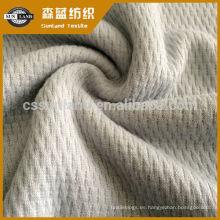 Tejido de algodón de poliéster tejido Heattech para ropa interior de invierno.