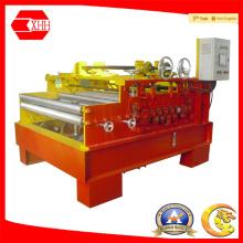 Machine de redressage de feuilles avec dispositif de coupe et de découpe