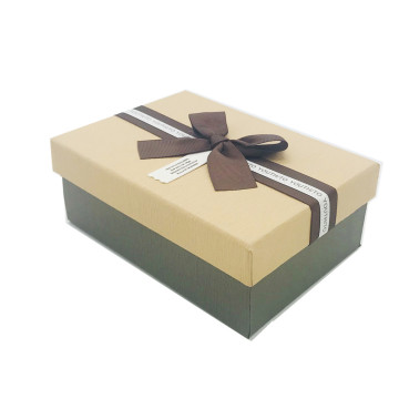 Top and bottom packaging box with ribbon