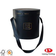 Boîte à fleurs ronde noire avec poignée en ruban