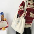 Compras de bordado em bolsa de lona em tecido