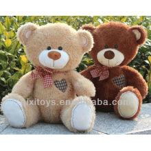 bebé oso de peluche con arco y corazón rojo bordado en el pecho derecho