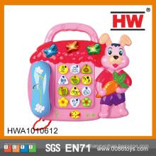 Venta caliente versión rusa de plástico niños juguete teléfono con música de luz