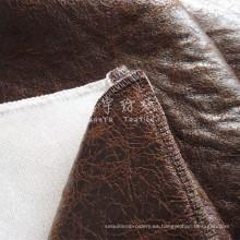 Tejido bronceado de cuero sintético con parte posterior adherida gruesa