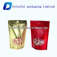 Les noix et le sac d'emballage de nourriture sèche avec la fenêtre / feuille d'aluminium tiennent le sac de tirette pour l'emballage alimentaire de noix