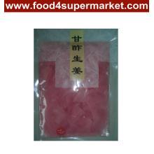 Fatia do gengibre do sushi do sushi branco e cor-de-rosa no saco e na garrafa