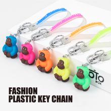 Porte-clés PVC orang-outan fluorescent