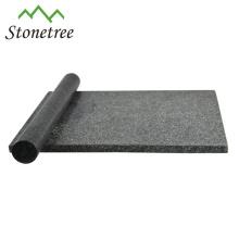 Schneidebrett aus schwarzem Granit mit Nudelholz