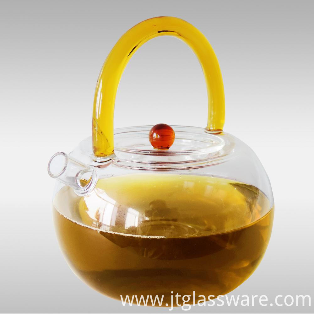glass teapot with kind of handle