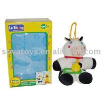 913990736-campana de bebé juguete de peluche de vaca
