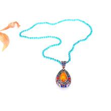Collier long pendentif perlé à la main turquoise