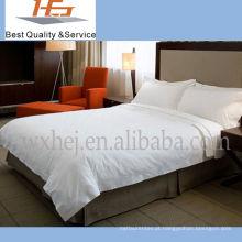 Folha descartável branca barata do hotel da cama