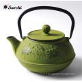 Théière en fonte verte avec poignée en acier inoxydable