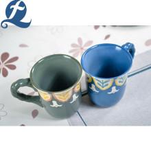 Tasse de café de peinture colorée de vente chaude avec la poignée