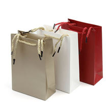 Factory price custom printed logo kraft gift jewelry shopping personalized colored paper packaging bag with rope handles