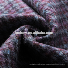 Graues, blaues, purpurfarbenes Woll-Tweed-Gewebe im Dogtooth-Tweed-Mantel