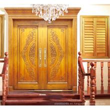 Puerta doble dorada de lujo con talla