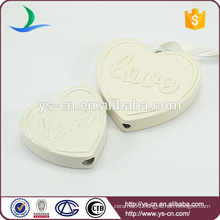 heart shape ceramic decoration with love relief