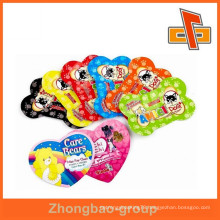 Fashion custom-made heart-shaped or bone shape unique shape bags for pet food from china manufacturer