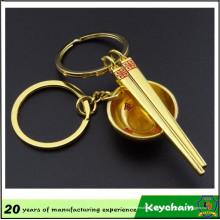 Llavero de palillos y cuenco de color oro 3D para amantes