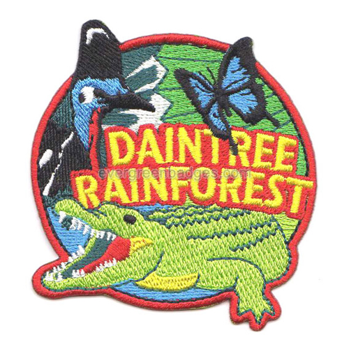 Badges bordés de papillons et alligators Rainforest